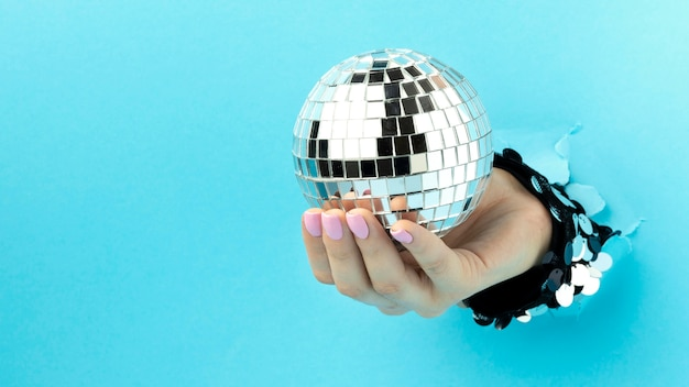 Close up hand and disco ball