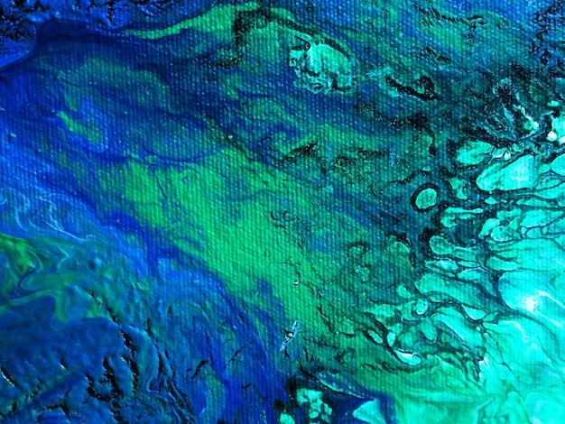 手描きのカラフルなオイルペイントの大理石の抽象的なテクスチャを閉じます。