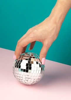 Close up hand having disco globe