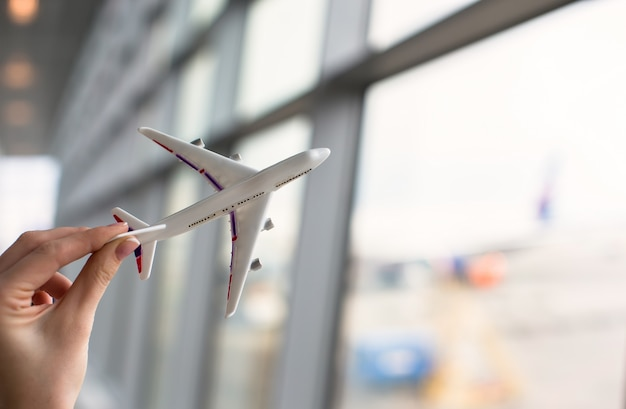 Close up hand holding an airplane model