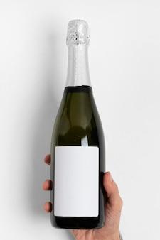 Close-up hand holding bottle