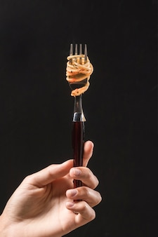 Close-up hand holding fork