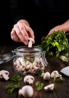 Close-up hand holding mushroom