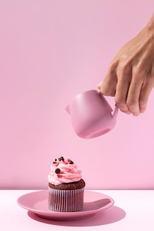 Close-up hand holding pink cup