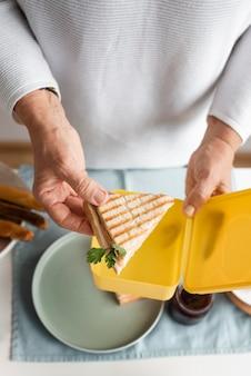 Close up hand holding sandwich