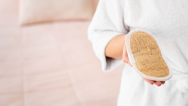 Close-up hand holding self care item