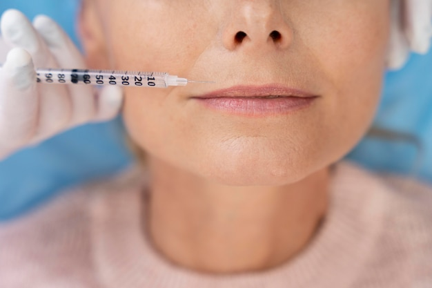 Close up hand holding syringe
