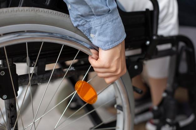 Close up hand holding wheel