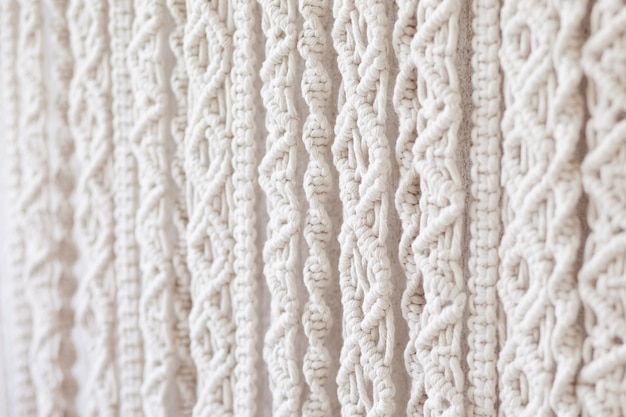 Close-up of hand made macrame texture pattern.