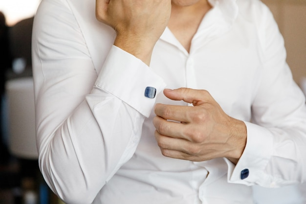 Close up of a hand man wears white shirt and cufflink