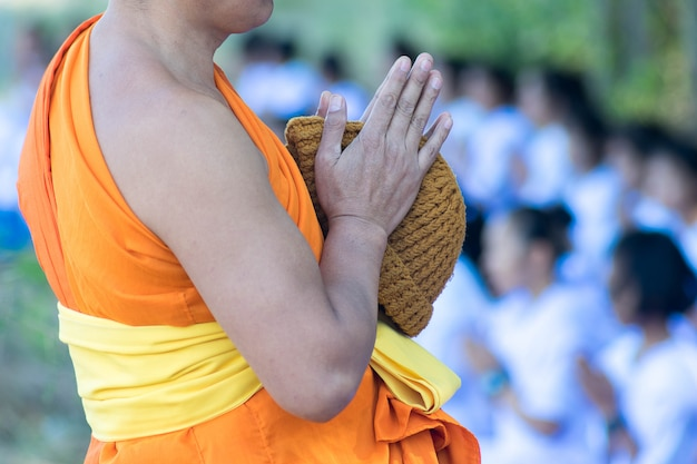 Close up to hand of monk pray gesture or greeting culture.