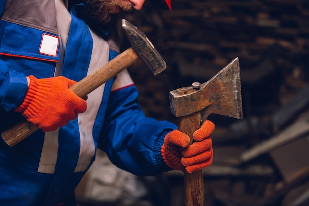 Close up of hand of repairman, professional builder working indoors, repairing