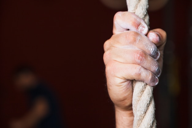 Close-up hand on rope