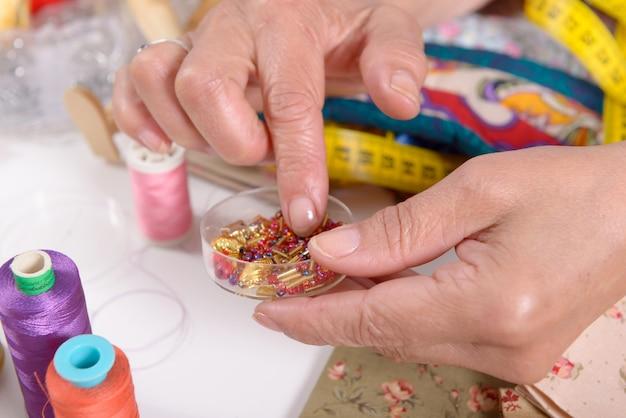 Close up of hand of seamstress