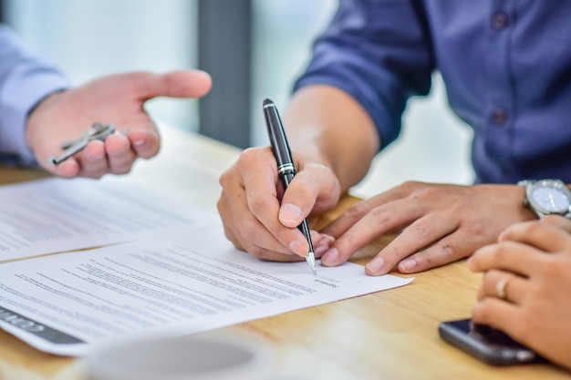 Close up hand sign contract buying home