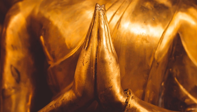 Close up hand of statue buddha.buddhism concept . focus and peacefulness concept idea