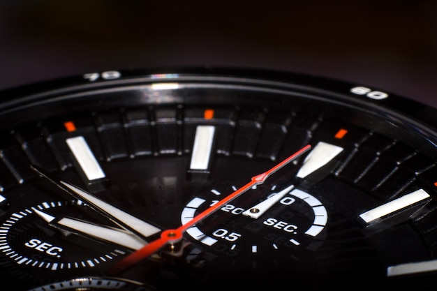 Close up of hand watch on black background.