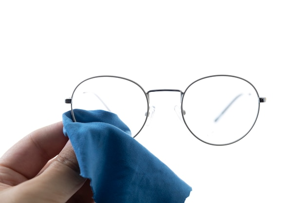 Close-up of a hand with a blue cloth that wipes the glasses