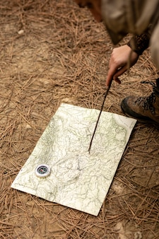 Close-up hand with stick and map