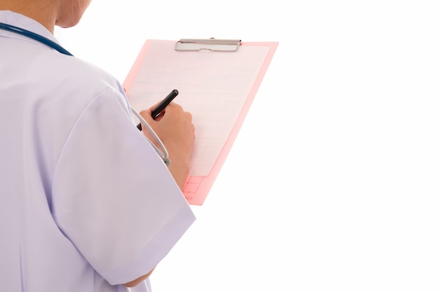 Close up hand of woman doctor writing a prescription on a clipboard on white back view, hands close up