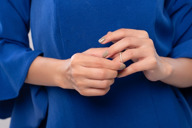 Close up hand of woman is taking off the wedding ring. break my heart and divorce concept.