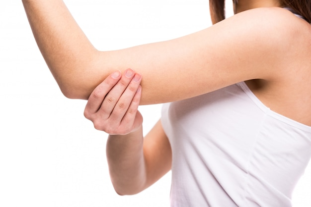 Close-up hand of young woman with a sore elbow.