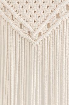 Close up of handmade cotton macrame panel.