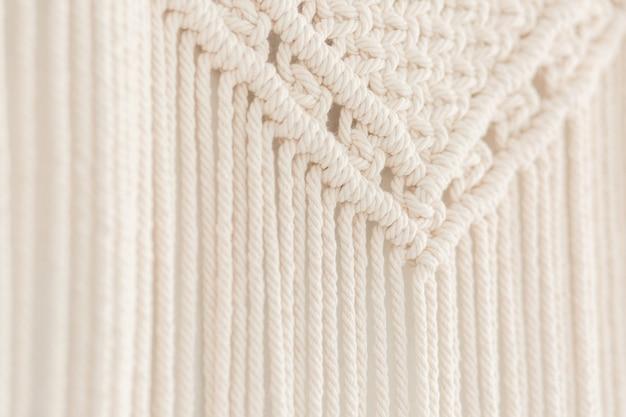 Close up of handmade cotton macrame panel