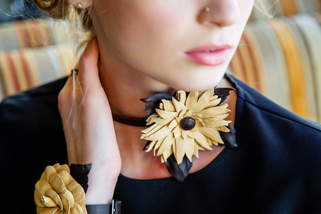 Close-up of handmade leather jewelry on a girl.