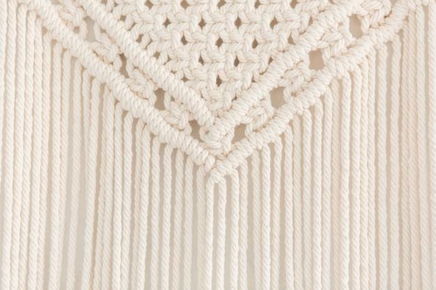 Close up of handmade macrame panel.