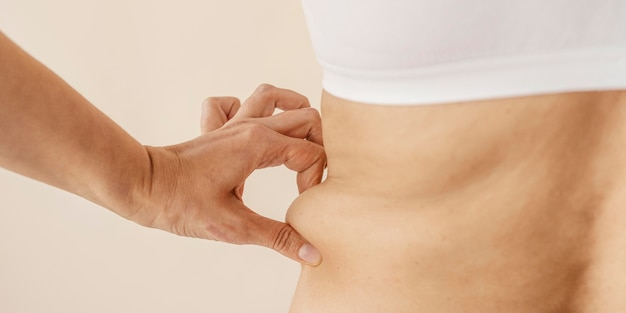 Close up hands holding body fat