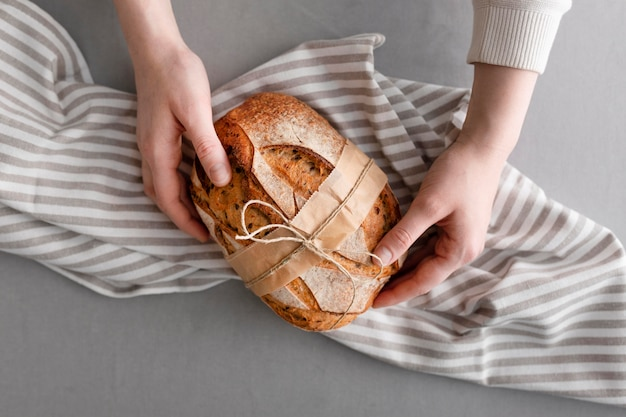 Close-up hands holding bread