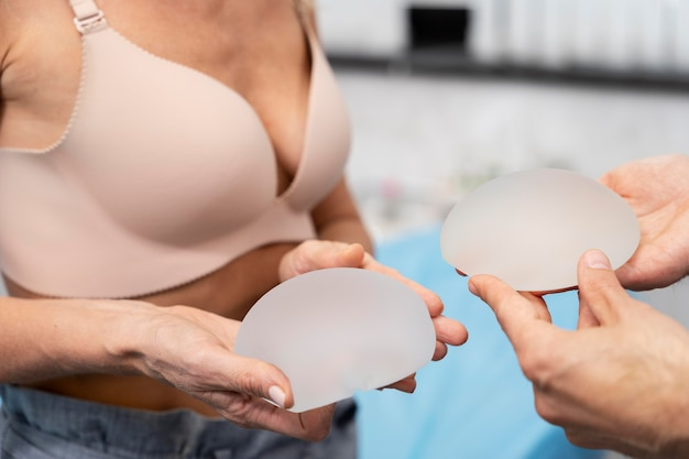 Close up hands holding breast implants