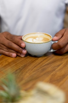 Close up hands holding coffee cup