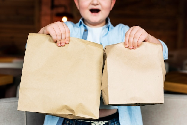 Close up hands holding paper bags