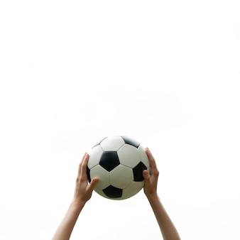 Close-up hands holding soccer ball