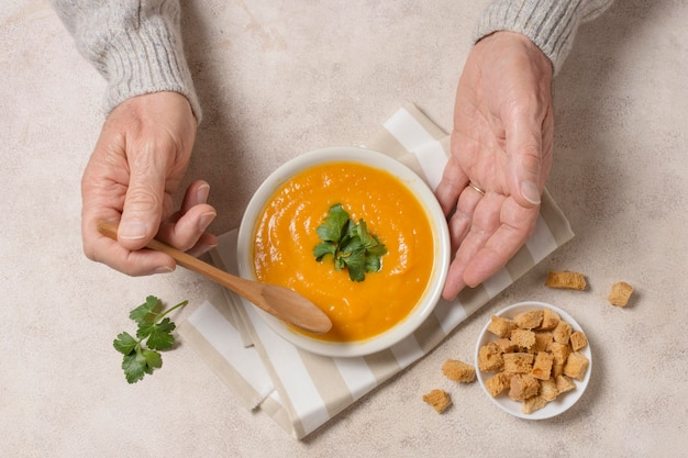 Close-up hands holding spoon and bowl