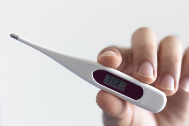 Close-up hands holding thermometer