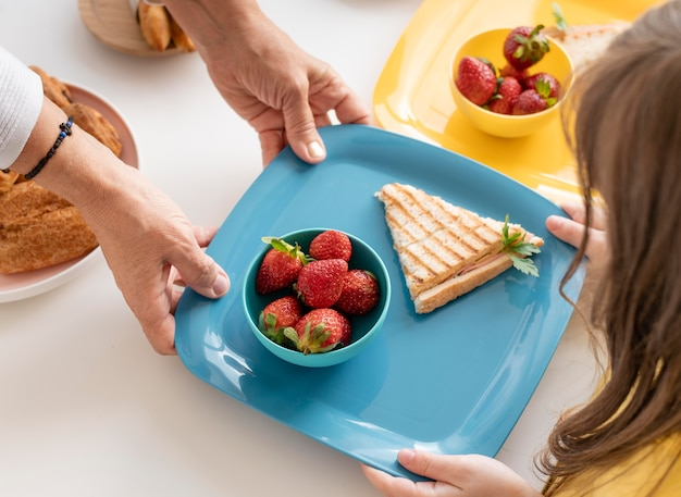Close up hands holding tray