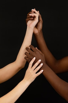 Close-up hands holding with dark background