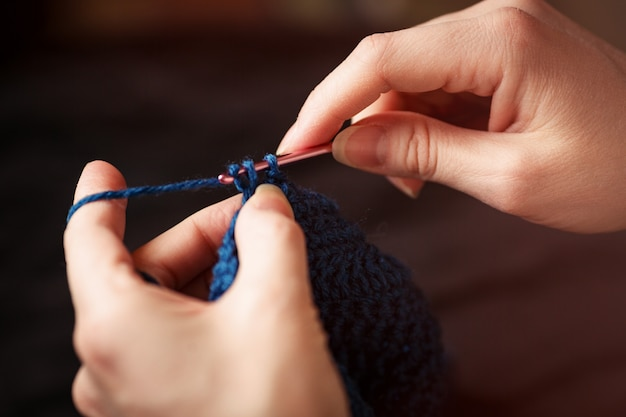 Close up of hands knitting