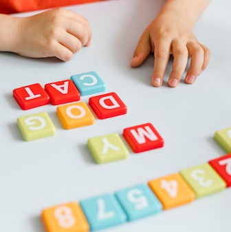 Close-up hands making words