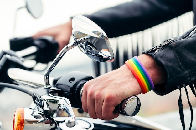 Close up of hands of a man with rainbow bracelet