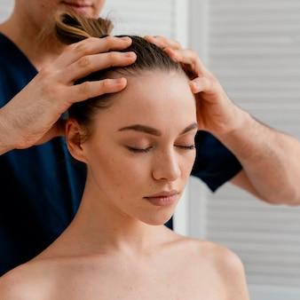 Close up hands massaging scalp