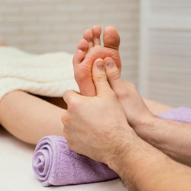 Close up hands massaging sole
