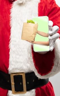 サンタクロース保持装置の手を閉じる