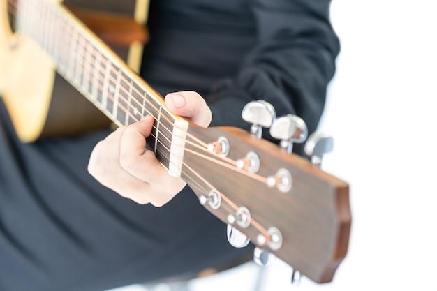 Close up hands playing guitar