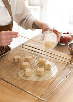 Close up hands preparing dessert