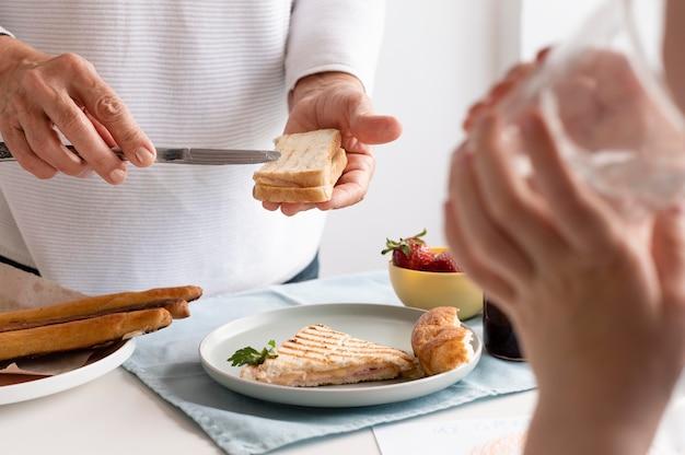 Close up hands preparing food