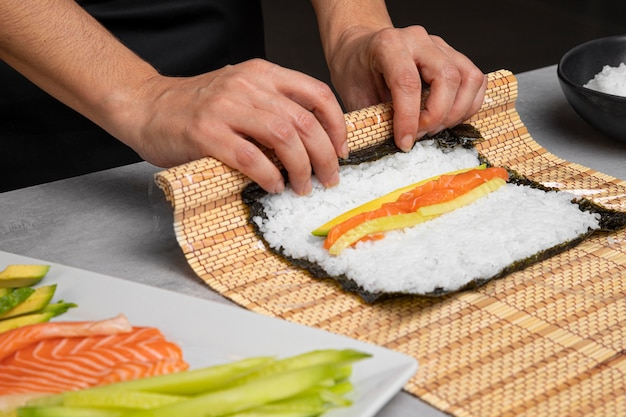 Close-up hands preparing sushi